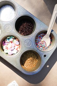 Use a muffin tin to hold ice cream toppings for a self-serve ice cream bar! Super cute and inexpensive - especially if you already have one at home!