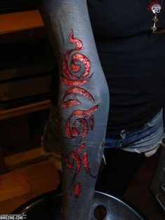 "One of the oldest forms of body modification is finally growing in popularity. With scarification, cuts between ¼"" and ¾"" are used to create scar tissue and imprint images upon the skin.   There are many reasons people would turn to scarification. For starters, they are more visible on dark-skinned people than tattoos. Also, unlike tattoos, scarifications are a product of one's own body. In addition to aesthetic reasons, endorphins are released during the process that can induce a euphoric…"