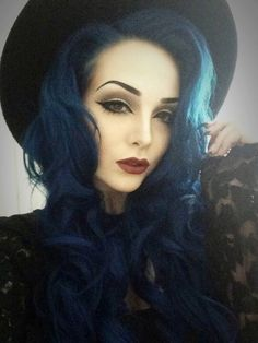 Deep blue hair and red lips