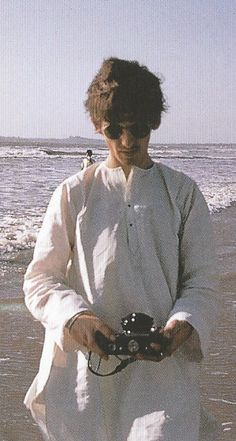 "thateventuality: "" Scan - George Harrison at the beach in Mumbai, India, 1966 Scanned from The Beatles Anthology """"It was the first feeling I'd ever had of being liberated from being a Beatle or a number."" - George Harrison, The Beatles Anthology "" """