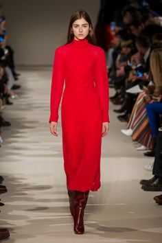 LADY IN RED. It can fee somewhat passe to call a color of the season, but when one stands out a voraciously as rad as for Fall, its influence is undeniable. Not since Titian and Valentino Garavani has the color enjoyed such prominence.