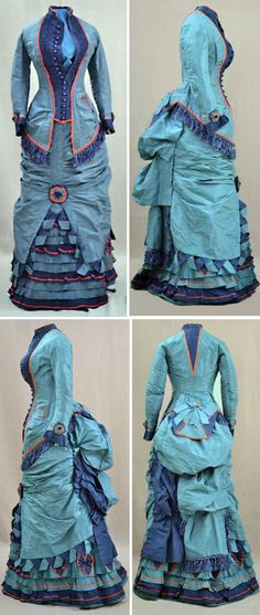 Two-piece dress, 1870. Pale blue silk. Bodice has button-down front with tiny dark blue crocheted buttons. Longer in back & pleated at side hips. Pleated pocket on side. Bustle skirt with draping and shirring. Slit up front to show ruffles and pleating of alternating shades of blue. Bright red silk trim around jacket, pocket, collar, sleeve edges, & ruffles. Fabric rosettes. Blue silk fringe at bodice & bustle. Towson Univ. Dep't of Theater Arts