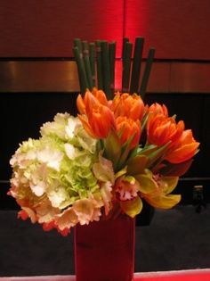 modern arrangement with horsetail, tulips, hydrangea and orchids