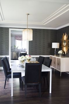 """""""This is one of my favorite rooms, especially because of our marble dining table. This is where we entertain family, friends, clients and colleagues — all over a great meal, wine and conversation."""" -Naina Singla"""