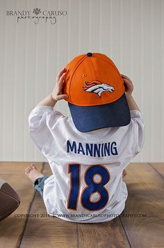 Brandy Caruso Photography | The Blog. Denver Colorado Baby/Toddler photographer. Natural light Thornton CO studio session. First birthday, smash cake, 12 month session with little boy. Broncos, Manning jersey.