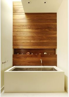 Vicariously through my boyfriend's obsession for soaking tubs, I have become more and more interested in the different types.  This particular one looks very relaxing and more natural thanks to the wood.