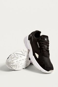 0567a05d1fd Shop adidas Originals Falcon Core Black Trainers at Urban Outfitters today.