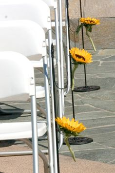 sunflowers on chairs - for wedding ceremony