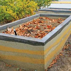 Rammed Earth Garden Beds - DIY - MOTHER EARTH NEWS beds are made by compressing a damp mixture of approx. 70% sand, 3% clay, & a small amount of cement into an externally supported form or mold, creating a solid, earthen wall after the frames are removed. One of the benefits of rammed earth is that its high thermal mass absorbs heat during the day and releases it at night.