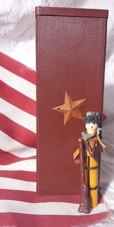 """Handmade Mini American Frontiersman. He comes equipped with accessories including a handpainted wooden box with a mounted rustic star measuring 8"""" X 3"""" painted in brown acrylic, a copy of the Declaration of Independence tied with a small rope, his KY long rifle, a powder horn, a tomahawk, a canvas knapsack and attached coonskin hat. http://www.trehanstreasures.com/"""