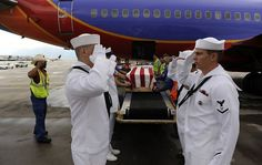 The flag-draped casket bearing the remains of Jonathan Blunk are loaded onto a plane bound for Reno for a full military funeral, at Denver International Airport July 27, 2012 in Denver, CO. Blunk, a five-year U.S. Navy veteran, was killed in the July 20 Century 16 shooting massacre in Aurora, Colorado. (Photo by RJ Sangosti-Pool/Getty Images) Photo: Pool, Getty Images    Read more: http://www.sfgate.com/news/article/Funerals-for-Aurora-victims-McQuinn-Ghawi-3743724.php#