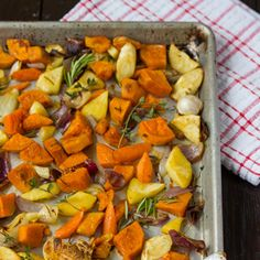 A platter of Roasted Winter Vegetables with fresh thyme and rosemary is an easy and delicious side for Thanksgiving.