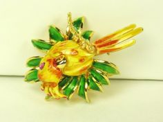 20% off Sale starts 6/4/16 until 6/18/16 A magnificent piece of Hattie Carnegie jewelry with enameling. This amazing brooch is a gorgeous #parrot that is sitting on a branch within an arrangement of foliage. The pi... #vintage #diamonds #gold #rings #necklace #enamel #judysgems2 #yellow #green #pin #woj #teamlove