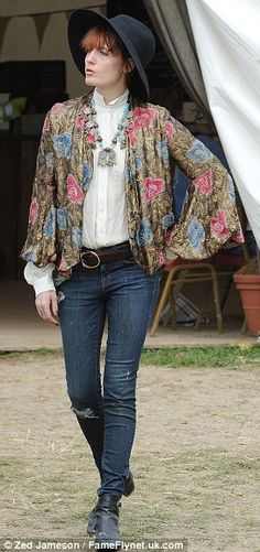 Fancy a change: Florence started off in a floral jacket over her blouse, before changing into a fringed number