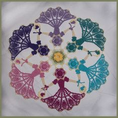 Friendship Garden Crinoline Circle Doily. Can you see the little girls? Each color is a different little girl in a frilled dress.... CUTE