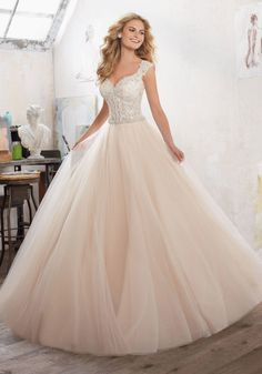 Wedding Dresses and Bridal Gowns by Morilee designed by Madeline Gardner. A Princess Ballgown with Crystal Beaded Embroidered AppliquŽés on Tulle Over Sparkle Net.