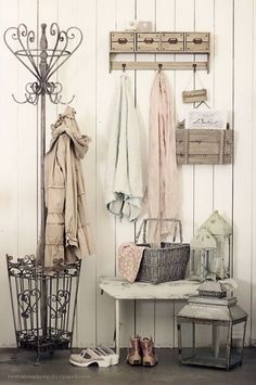 Vintage chic entryway with the rustic coat/ umbrella rack.