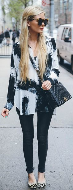 Via Just The Design: Amber Fillerup Clark is wearing a Fifteen Twenty black and white blouse with a pair of Anine Bing black skinny jeans and a Yosi Samra leopard print pumps
