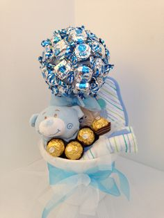 Chocolate Baby Boy Tree Contains Snuggle tedding with teething ring, Hooded Towel, three baby face clothes and chocolates