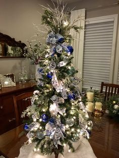 wired navy/royal blue/silver ribbon (Etsy) paired w/ sheer white/silver ribbon. All ribbon,stems and ornaments securely wired - ready for display every year! Christmas Tree Colour Scheme, Christmas Tree Roses, Blue Christmas Tree Decorations, Elegant Christmas Trees, Silver Christmas Tree, Colorful Christmas Tree, Christmas Centerpieces, Holiday Tree, Xmas Tree
