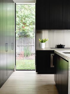 full height window in kitchen next to full cupboard Mosh House / Foong + Sormann