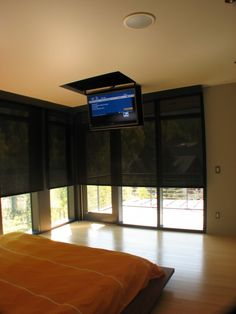Love the idea of a fold out tv and motorized window treatments. Genius.