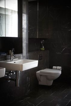 Clever concealing of wall-hung toilet tank and other bathroom plumbing @ The Stamford Residences with Laufen products