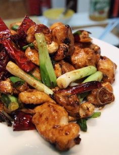 Yield: 2 Servings    Ingredients:    8 oz (250g) skinless, boneless chicken breast, cut into bite-sized cubes  1 tsp Chinese rice wine or sherry  1 tbs cornstarch  2 tbs oil  1 tbs Szechuan Peppercorn Oil  1 clove garlic, thinly sliced  One 1 inch (2.5cm) piece fresh ginger, peeled