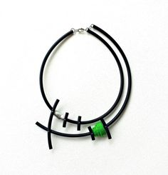 Fabulous contemporary necklace, made of black rubber - pvc tube, green felt and aluminum. A must have accessory to jazz up your wardrobe. Length: 21.3 inch / 54 cm Diameter: 6.5 inch / 16.5 cm Package will be shipped out as soon as I possibly can which is usually 1-2 days after the purchase. ▲ FREE GIFT WITH EVERY ORDER ▲ Dont hesitate to contact me if you have any question.. Thanks for stopping by and dont forget to check my other items. Join Pevalek Jewellery at https://www.facebook.com...