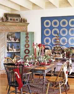Ideas for Christmas displays from Country Living, but I'm looking at that blue quilt on the wall, stunning