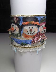 A very very cold Snowman Cuff...scenic snow scene and icicles. www.beadsbeadingbeaded.com