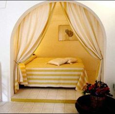 Love this Cozy Alcove Bed from Apartment Therapy. When it's time to sleep, just pull back the curtain.   Tiny Homes