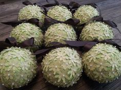 READY TO SHIP. Lime Green Flower Paper Pomander Kissing Wedding Ball with Chocolate Browm Ribbon and Pearl Pin Accent (Set of 3). $20.00, via Etsy.