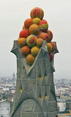 Gaudi Tile Mosaic Fruit Spire   -    Sagrada Familia  -    Barcelona   -    2006  -   Matthew Gudenius photography   -  https://www.flickr.com/photos/kidelectric/381238943/