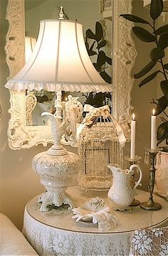 This looks just like the corner in my living room. I like the big mirror hanging behind the table♥ the lamp base made from old bath oil pitcher!
