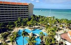 Overlooking the aquamarine Caribbean Sea, this hotel is located on the exclusive Palm Beach, just minutes away from Queen Beatrix Airport. This resort is filled with Caribbean flavor, from the finely appointed rooms to th...