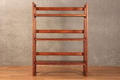 Handy danish modern folding shelf featuring 3 tiers and an open-shelf design. A wonderful piece that can be easily stored and transported. In good condition with some nicks to the surface. Dimensions: 28 w 12...