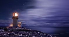 The lighthouse at Lindesnes, the southern most point in Norway. by Kristian Thuesen