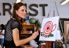 Catherine, Duchess of Cambridge paints a picture during a visit to Inner City Arts on July 10, 2011 ... - Pool/Getty Images