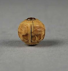 Carved bead  Date: 19th century Culture: Japan Medium: Ivory Dimensions: H. 1/2 in. (1.3 cm); W. 1/2 in. (1.2 cm) Classification: Ojime