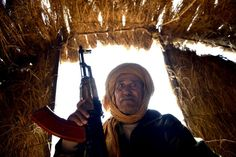 Bechir Mohamed, the chief of security in the Al-Mahbes area in the Western Sahara poses fo...