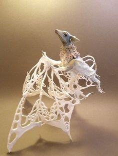so many questions with this, but pretty net if the bat needed artificial wings. Bat with Carved Wings