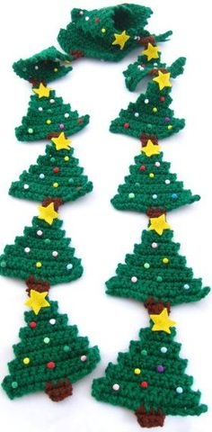 Christmas Tree Scarf Pattern @Vanessa Samurio Mayhew: This free Christmas crochet pattern shows you how to make a fun holiday Christmas tree scarf. Tree (make 14) Row 1: with paddy green ch 14, sc in 2nd ch from hk, sc in each ch across, turn. (13)...