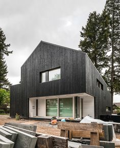 passive house with fire treated wood cladding - campos leckie