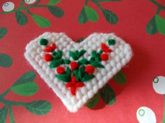 Hey, I found this really awesome Etsy listing at https://www.etsy.com/listing/117749083/plastic-canvas-christmas-heart-magnet