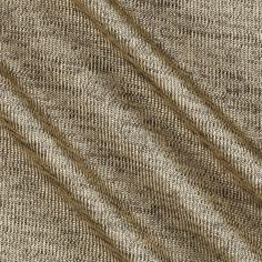 Galaxy Jersey Knit Gold from @fabricdotcom  This glitzy jersey knit fabric is perfect for creating T-shirts, tanks, and knit skirts or dresses with a lining. It features 25% stretch across the grain and pearlized threads that create a shimmery look.
