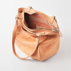 IL BISONTE  DOUBLE STRAP WITH DOUBLE POCKET BAG IN NATURAL