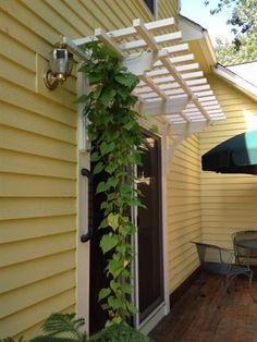 Arbor as door canopy.  I'd just need brackets for the garage entry door.