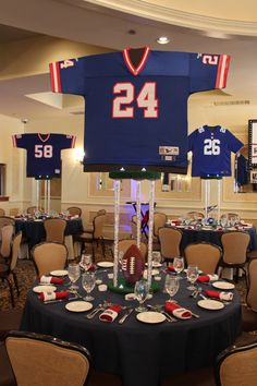 Football sports jersey centerpiecesfootball sports jersey centerpieces with sports equipment sports banquet centerpieces, banquet decorations Sports Themed Centerpieces, Football Centerpieces, Banquet Decorations, Banquet Ideas, Cheer Banquet, Football Banquet, Football Themes, Football Decor, Football Moms