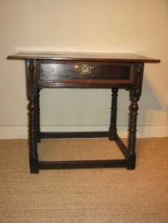 A FINE LATE 17TH CENTURY OAK SIDE TABLE OF EXCELLENT COLOUR AND PATINATION:-THE PLANKED TOP ABOVE A FRIEZE DRAWER WITH MOULDED EDGE, STANDING ON FOUR RING AND BOBBIN TURNED LEGS, UNITED BY STRETCHERS.
